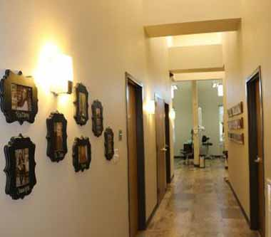 Photo of the hallway and patient treatment area at Bayou Dental Group in Monroe, LA, the office of Dr. David Finley and Dr. P.J. Henderson.