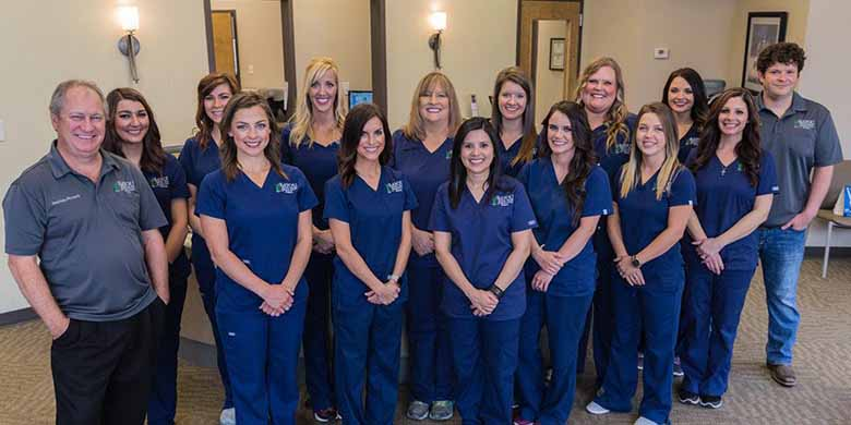 Team photo of dentists and staff members at Bayou Dental Group in Monroe, LA.