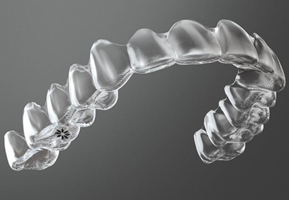 Photo of an upper aligner for Invisalign, which is offered by Monroe, LA dentist Dr. David Finley.