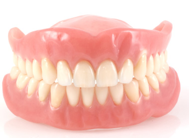 Photo of natural-looking upper and lower dentures.